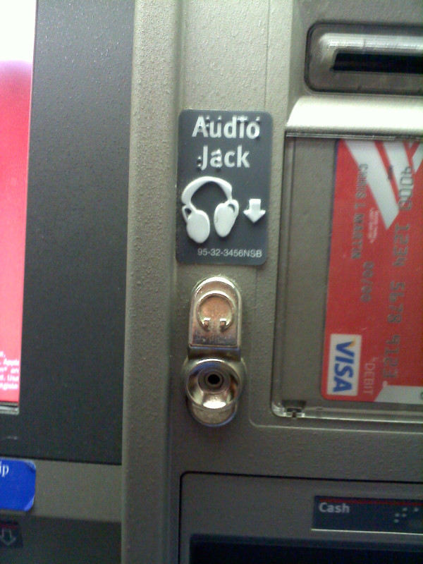 Audio Jack written in print and braille with a headphone icon and the headphone jack below.